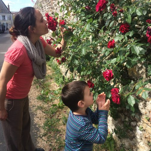 Woman and child smelling the roses
