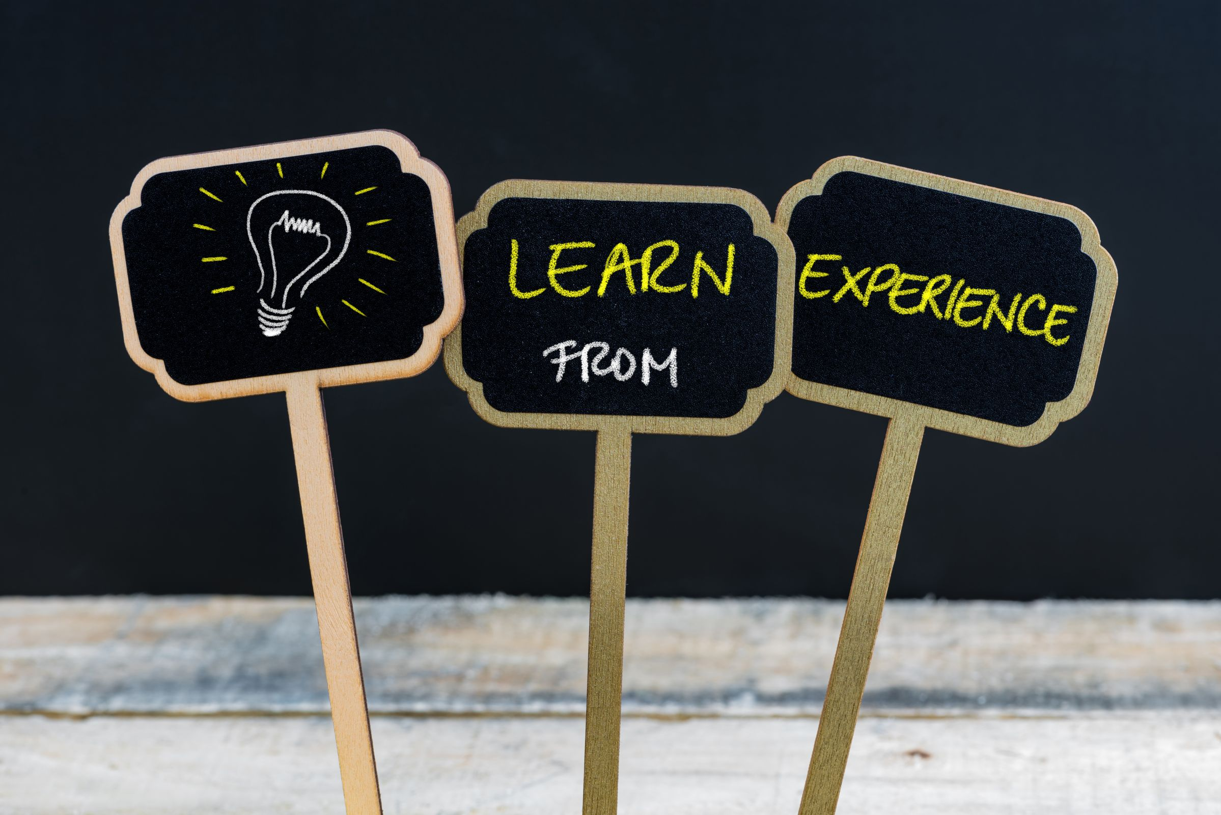 Picture of 3 signs saying Learn from experience. represents that Learning from experience is a Property Investing Secret you should always remember