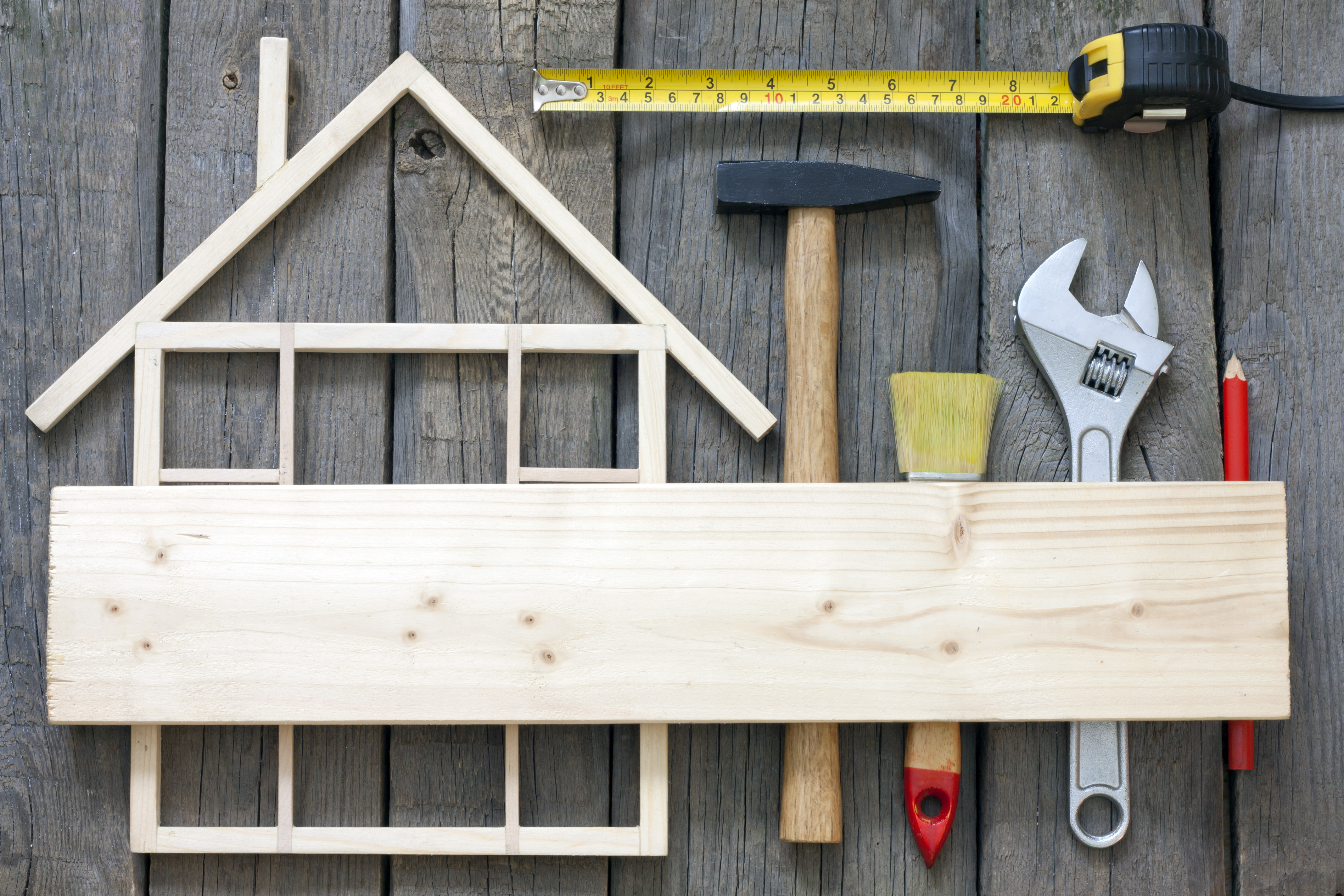 image of a wood made house frame and tool - raises the question if Renovation is the Right Property Investing Strategy For You